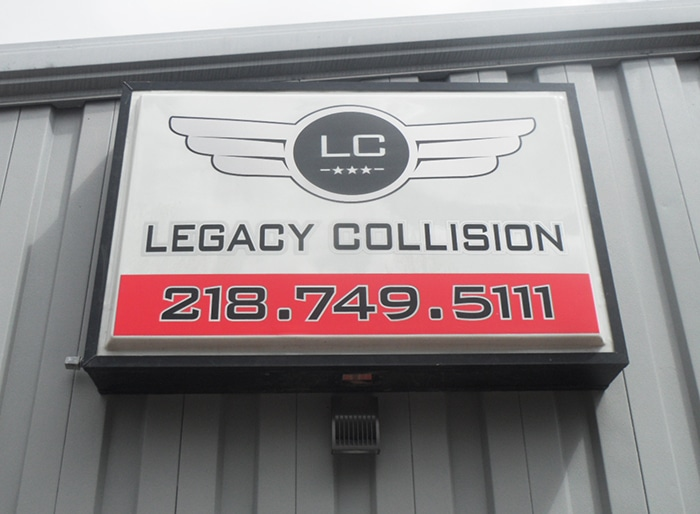 Sign with logo and phone number for collision repair